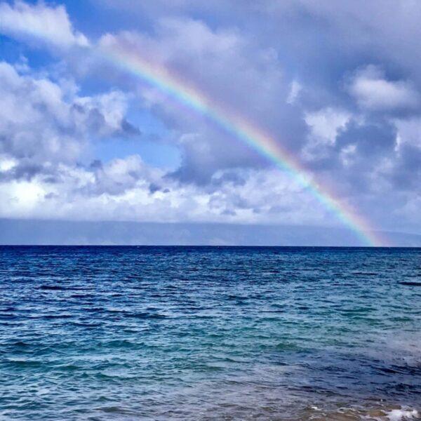 Rainbow over ocean in Maui Hawaii