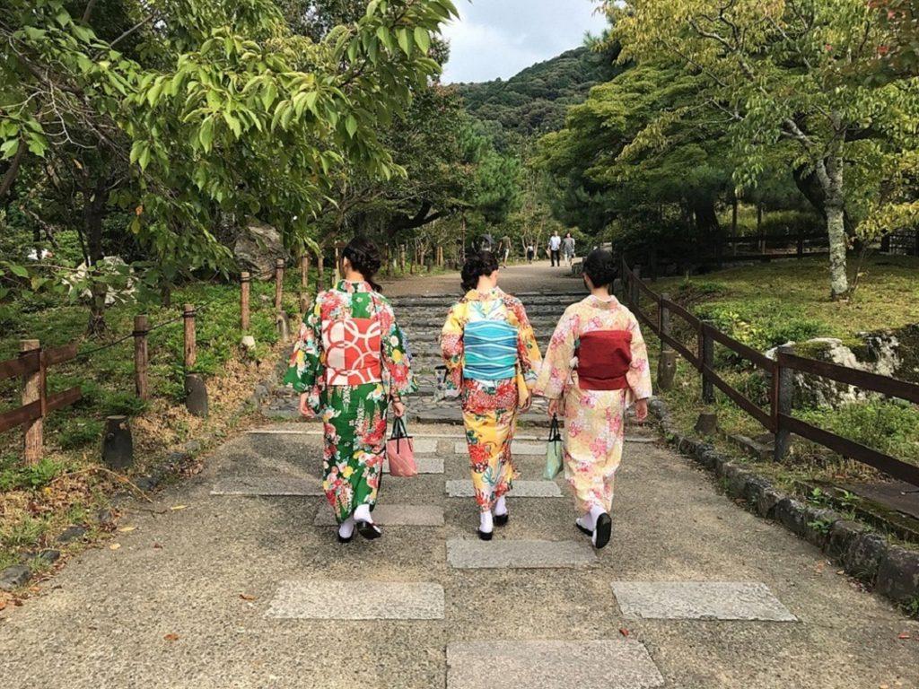 3 Japanese women adorned in classy kimonos