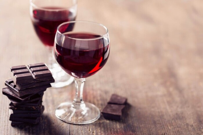 Chocolate and wine on a wooden board