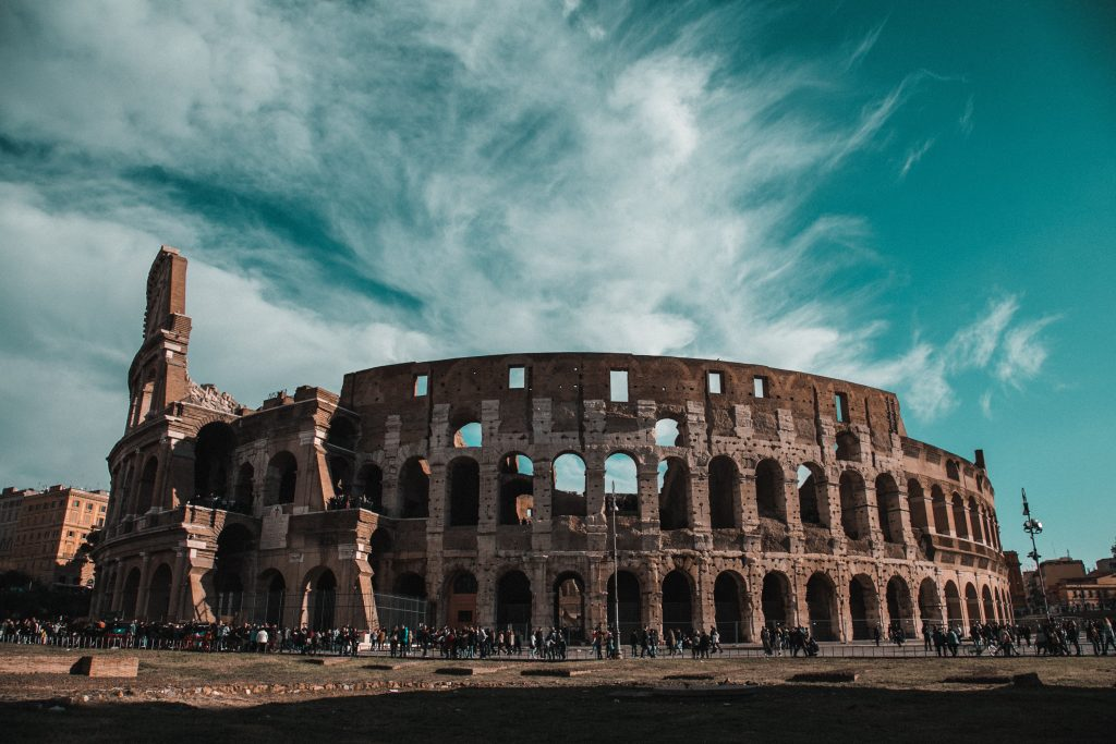 Roman Colosseum in bright blue sky with no people