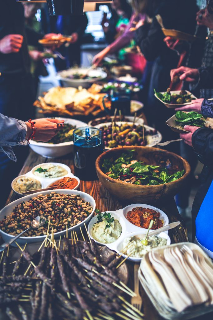 large bowls and plates of food down a long table