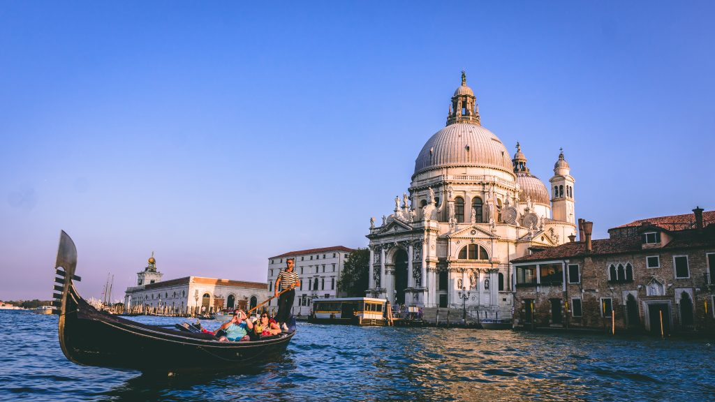 gondola in venice canal with historical building in background