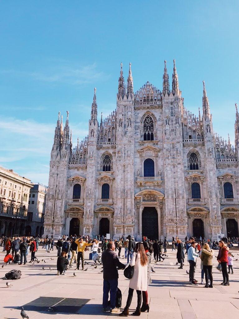 Milan Duomo Cathedral with people walking around it
