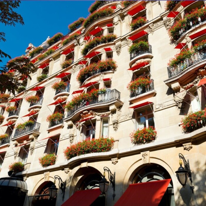 Red awnings and geraniums give the Hotel Athenee its Parisian look.