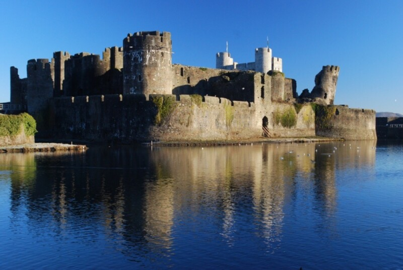 Caerfilly Castle rises above the lake.