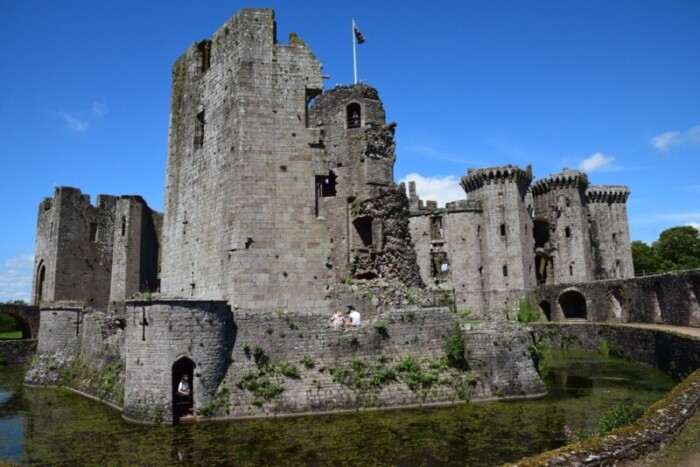 The Yellow Tower and Moat of Raglan Castle with Main Castle in Background