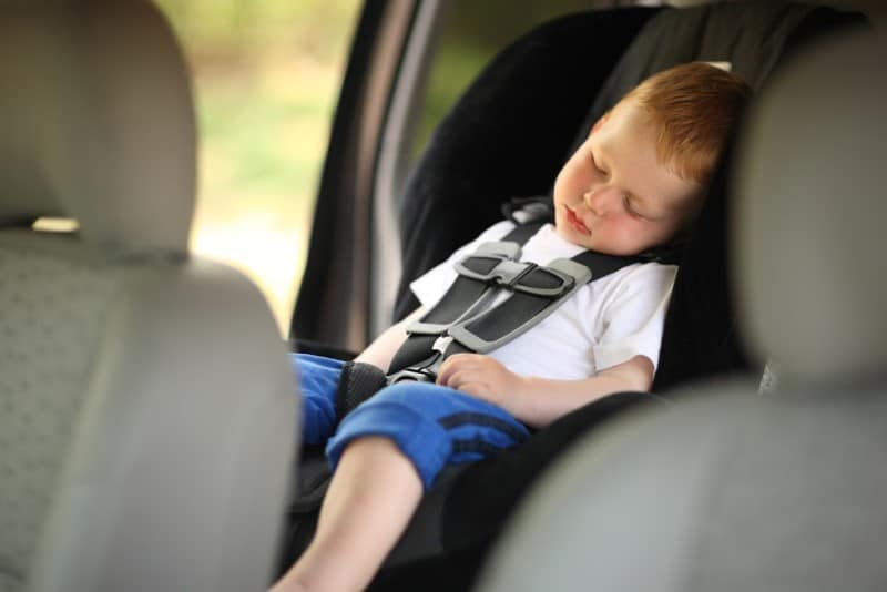 Kid sleeping in the backseat