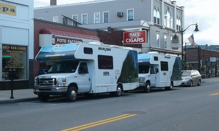 Two RVs parked on a town street