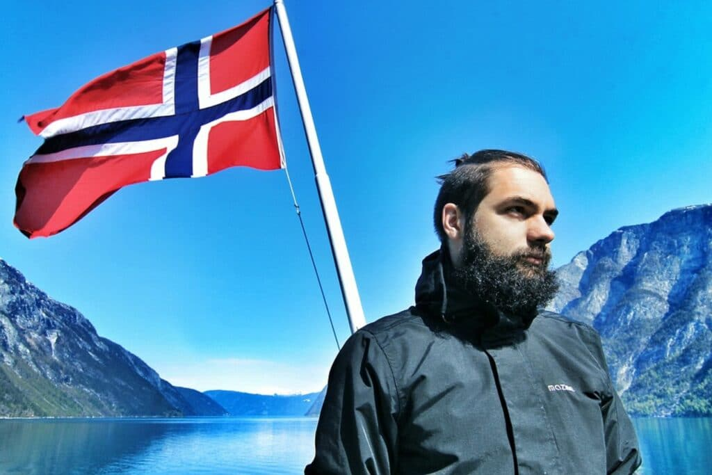 A man standing with the flag of Norway