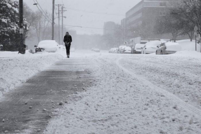 Man walking alone on a harsh snowy day in Minneapolis