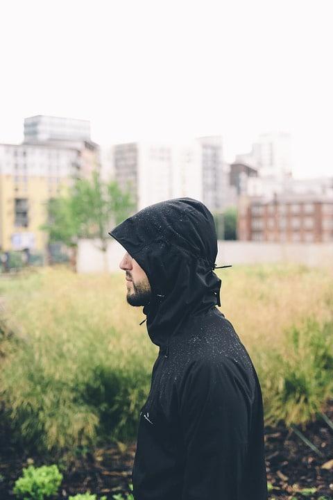 man in travel hoodie