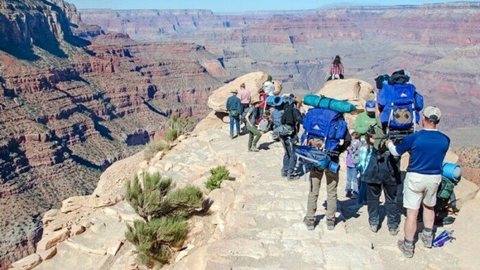 People with camping gear hiking the Grand Canyon.