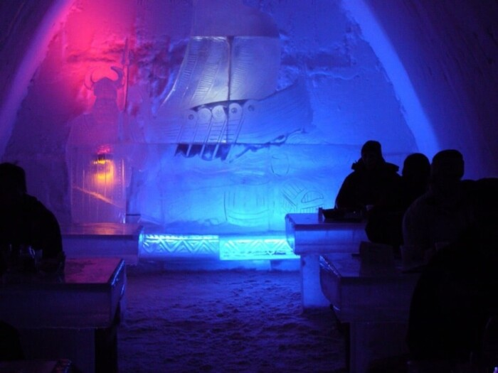 Ice bar illuminated at night.
