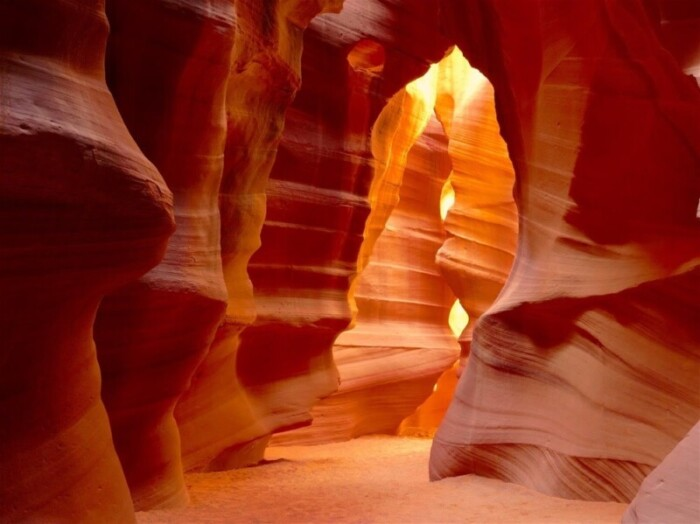 The worn red rocks of Antelope Canyon glow red