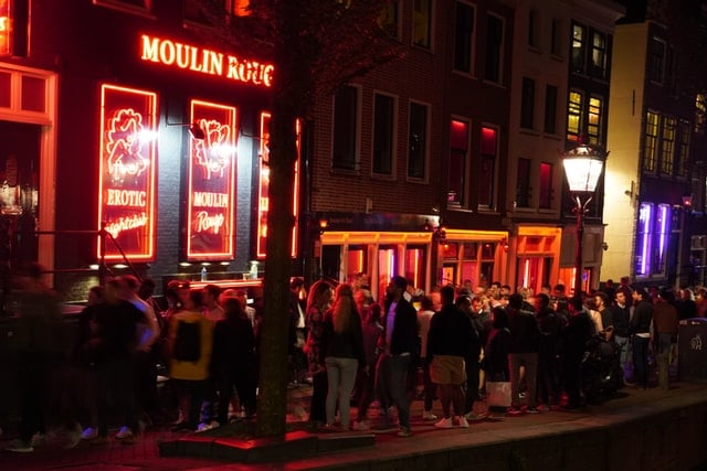 The crowds starting to build in De Wallen at night, Amsterdam