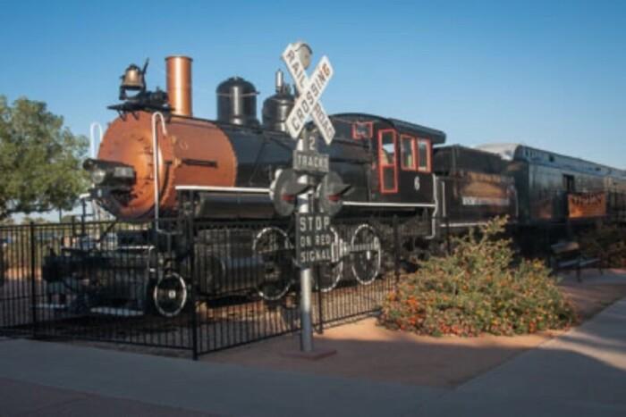 Train engine at railway crossing