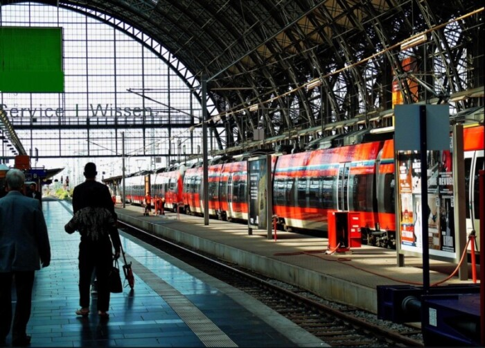 German station with red trains waiting