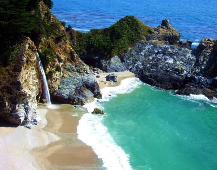 McWay Falls plunges off a cliff and into a turquoise cove.