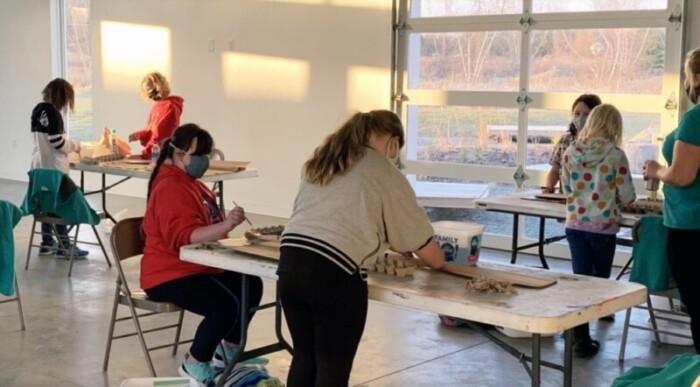 Students take an art class.