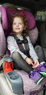 young girl secured in a Britax ClickTight Harness 2 Booster car seat