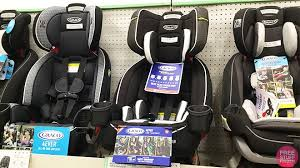 3 Graco 4Ever DLX 4 in 1 car seats on display