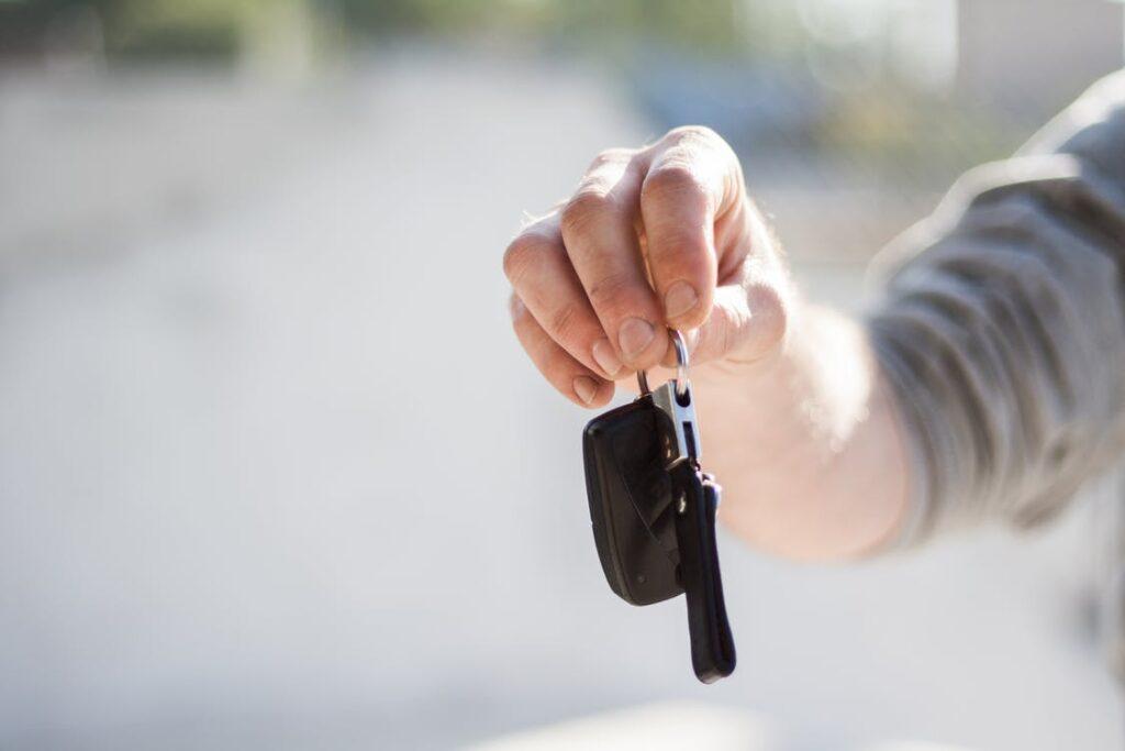 man handing keys over