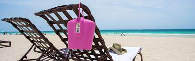 Pink SAFEGO secured on a beach bench