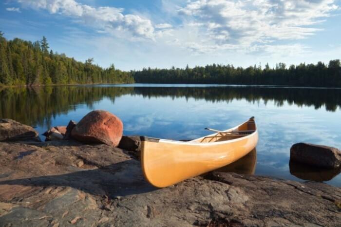 yellow-canoe-on-rocky-shore
