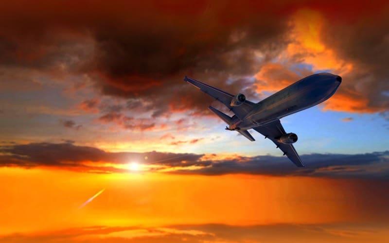 Airplane banks at sunset.