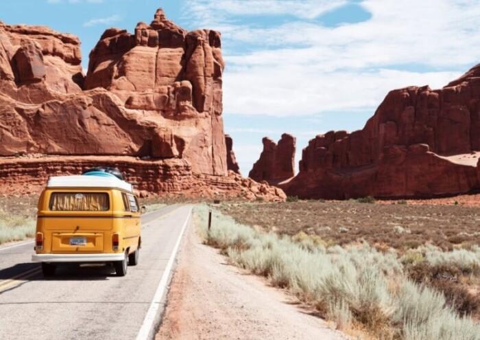 An RV driving through a canyon