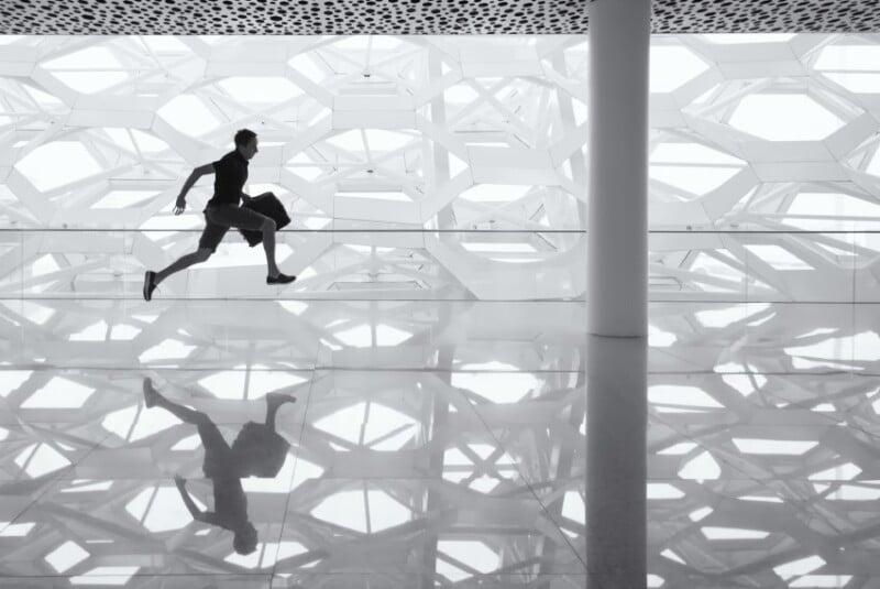 Man running in an airport