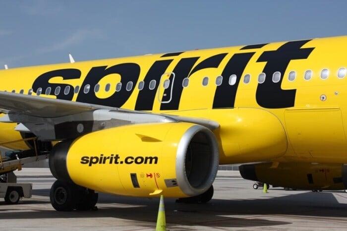 Yellow exterior of Spirit plane on tarmac