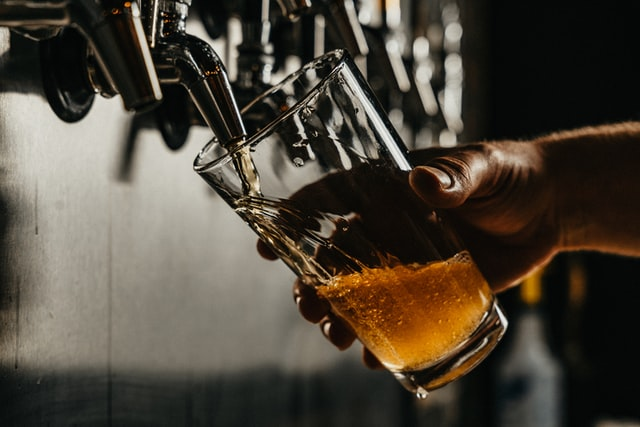 craft beer being poured into a glass